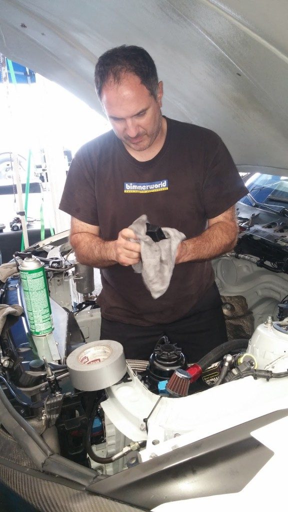 Lance Boicelli cleaning a BimmerWorld engine bay